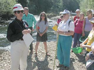 Photo of Mamie Brouwer, project manager, speaking with local boaters