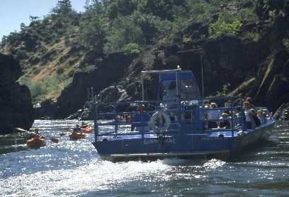 BLM photo of Jetboat passing a group of boaters in inflatable kayaks